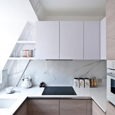 Small trendy u-shaped kitchen photo in London with an undermount sink, flat-panel cabinets, white cabinets, quartz countertops, white backsplash, white appliances, no island and stone slab backsplash