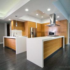 Midcentury Kitchen by Studio Jhoiey Inc.