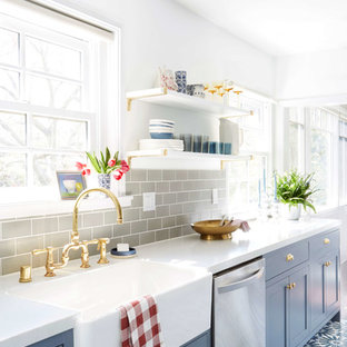 Eclectic kitchen inspiration - Eclectic kitchen photo in San Francisco with blue cabinets, gray backsplash and ceramic backsplash