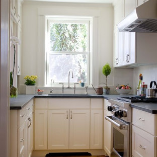 Inspiration for a small traditional separate kitchen in Boston with stainless steel appliances, recessed-panel cabinets, white cabinets and white splashback.