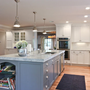 Traditional open concept kitchen inspiration - Inspiration for a timeless open concept kitchen remodel in Newark with stainless steel appliances, gray cabinets, recessed-panel cabinets, marble countertops and white backsplash