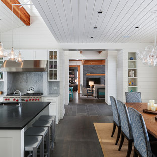 Mid-sized transitional eat-in kitchen photos - Example of a mid-sized transitional dark wood floor eat-in kitchen design in Minneapolis with an island