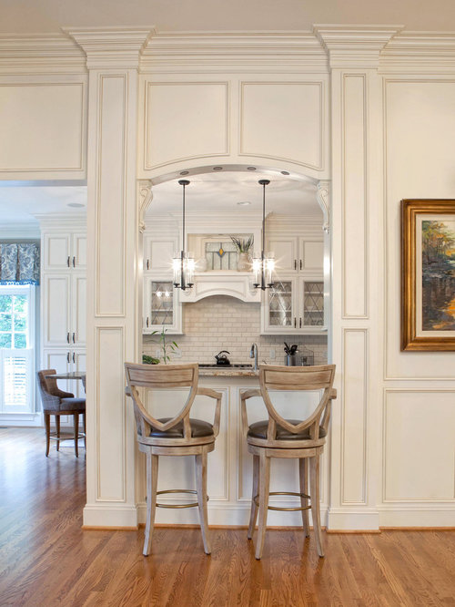 Superior Elegant Bar Stools For Kitchen Part - 11: Example Of A Classic Kitchen Design In Charlotte With White Cabinets And  White Backsplash