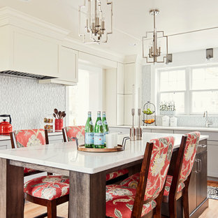 Mid-sized transitional enclosed kitchen photos - Inspiration for a mid-sized transitional u-shaped medium tone wood floor and brown floor enclosed kitchen remodel in Other with an undermount sink, shaker cabinets, gray cabinets, quartz countertops, multicolored backsplash, glass sheet backsplash, stainless steel appliances, an island and white countertops