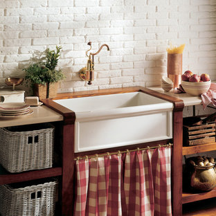 Mid-sized farmhouse kitchen inspiration - Inspiration for a mid-sized cottage light wood floor kitchen remodel in Miami with an undermount sink, white backsplash, stone tile backsplash and open cabinets