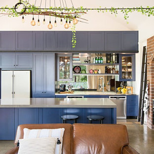 Design ideas for an eclectic l-shaped open plan kitchen in Brisbane with shaker cabinets, blue cabinets, stainless steel benchtops, stainless steel appliances, concrete floors, with island and grey floor.