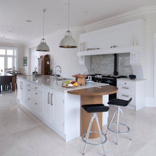 Example of a classic kitchen design in Belfast with an island