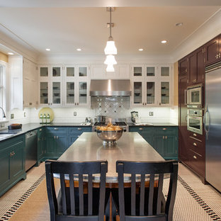 Large traditional enclosed kitchen ideas - Large elegant u-shaped enclosed kitchen photo in Seattle with a double-bowl sink, glass-front cabinets, stainless steel appliances, blue cabinets, solid surface countertops, white backsplash, subway tile backsplash and an island