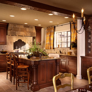 Inspiration for a rustic eat-in kitchen remodel in New York with a farmhouse sink, raised-panel cabinets, dark wood cabinets and beige backsplash
