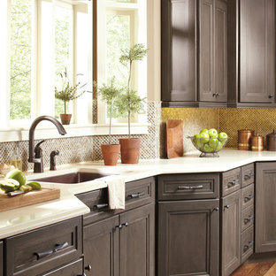 Kitchen - traditional l-shaped kitchen idea in Salt Lake City with an undermount sink, recessed-panel cabinets, gray cabinets, granite countertops, multicolored backsplash, mosaic tile backsplash and stainless steel appliances