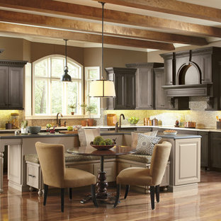 Elegant l-shaped eat-in kitchen photo in Salt Lake City with recessed-panel cabinets, gray cabinets, stainless steel appliances, an undermount sink, granite countertops, multicolored backsplash and mosaic tile backsplash