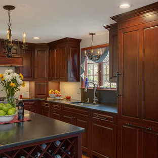 Traditional eat-in kitchen pictures - Inspiration for a timeless l-shaped medium tone wood floor eat-in kitchen remodel in Boston with a drop-in sink, raised-panel cabinets, dark wood cabinets, solid surface countertops and an island