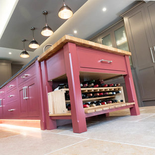 Inspiration for an expansive classic galley kitchen/diner in Hertfordshire with a built-in sink, recessed-panel cabinets, brown cabinets, quartz worktops, integrated appliances, terracotta flooring, an island, beige floors and grey worktops.