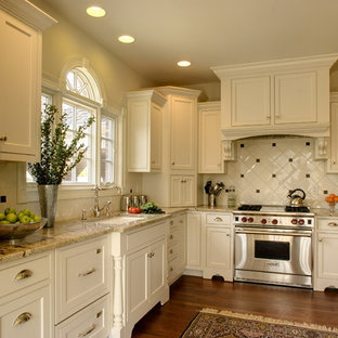 Traditional kitchen inspiration - Kitchen - traditional l-shaped kitchen idea in Indianapolis with granite countertops, an undermount sink, beaded inset cabinets, white cabinets, white backsplash and stainless steel appliances