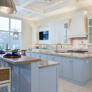 Large transitional u-shaped open plan kitchen in Miami with an undermount sink, recessed-panel cabinets, purple cabinets, marble benchtops, multi-coloured splashback, subway tile splashback, stainless steel appliances, porcelain floors, multiple islands, beige floor and beige benchtop.