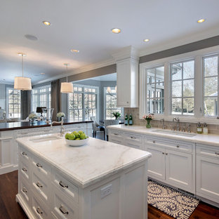 Traditional kitchen pictures - Elegant kitchen photo in Chicago with beaded inset cabinets, white cabinets and two islands