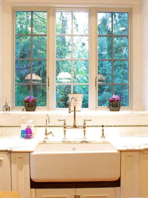 Traditional Kitchen Idea In Newark With A Farmhouse Sink, Marble  Countertops, Recessed Panel