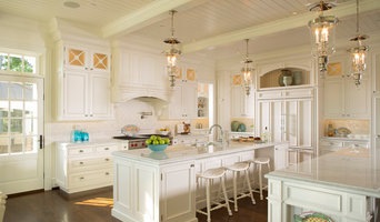 Classic white kitchen featuring double island.