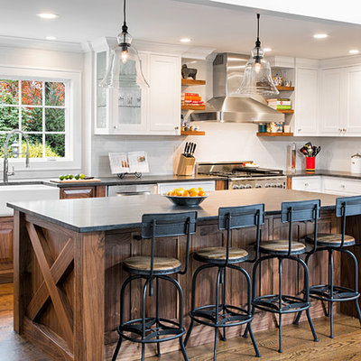 Large country u-shaped medium tone wood floor eat-in kitchen photo in New York with a farmhouse sink, shaker cabinets, white cabinets, granite countertops, white backsplash, ceramic backsplash, stainless steel appliances and an island