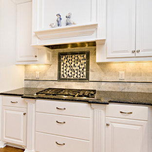 Large traditional eat-in kitchen ideas - Eat-in kitchen - large traditional l-shaped eat-in kitchen idea in Raleigh with an undermount sink, raised-panel cabinets, white cabinets, granite countertops, white backsplash, subway tile backsplash, white appliances and two islands