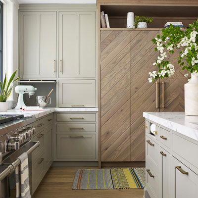 Inspiration for a large transitional l-shaped light wood floor and beige floor open concept kitchen remodel in New York with an undermount sink, shaker cabinets, light wood cabinets, marble countertops, white backsplash, marble backsplash, stainless steel appliances, an island and white countertops