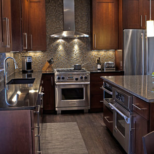 Example of a trendy l-shaped kitchen design in Other with quartz countertops, stainless steel appliances, shaker cabinets, dark wood cabinets and stone tile backsplash