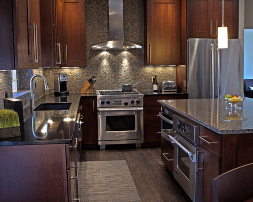 Example Of A Trendy L Shaped Kitchen Design In Other With Quartz  Countertops, Stainless