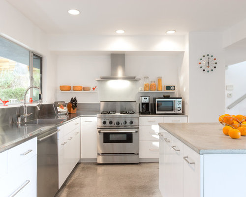 Midcentury Modern L Shaped Concrete Floor Kitchen Photo In Los Angeles With  An Integrated Sink