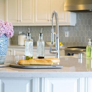 Large transitional kitchen ideas - Kitchen - large transitional kitchen idea in Orange County with an island