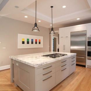 Mid-sized contemporary eat-in kitchen ideas - Mid-sized trendy l-shaped light wood floor eat-in kitchen photo in New York with a single-bowl sink, recessed-panel cabinets, white cabinets, marble countertops, beige backsplash, glass sheet backsplash, stainless steel appliances and an island