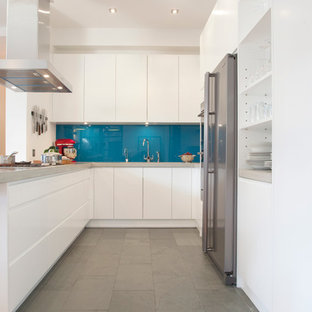 Inspiration for a modern kitchen in London with stainless steel appliances.