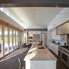 Modern Kitchen by RVP Photography