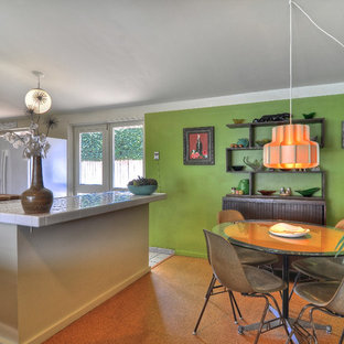 This is an example of a midcentury eat-in kitchen in Orange County with tile benchtops and white appliances.