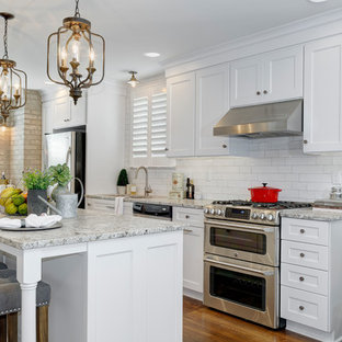 Mid-sized traditional eat-in kitchen appliance - Inspiration for a mid-sized timeless single-wall medium tone wood floor and brown floor eat-in kitchen remodel in Columbus with an undermount sink, shaker cabinets, white cabinets, granite countertops, white backsplash, subway tile backsplash, stainless steel appliances and an island