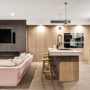 Contemporary kitchen designs - Kitchen - contemporary limestone floor and gray floor kitchen idea in Melbourne with a double-bowl sink, recessed-panel cabinets, light wood cabinets, concrete countertops, black backsplash, glass sheet backsplash and an island