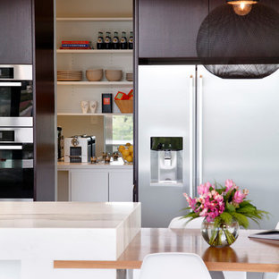Enclosed kitchen - mid-sized modern l-shaped porcelain floor enclosed kitchen idea in Sydney with an undermount sink, flat-panel cabinets, black cabinets, marble countertops, stainless steel appliances and an island