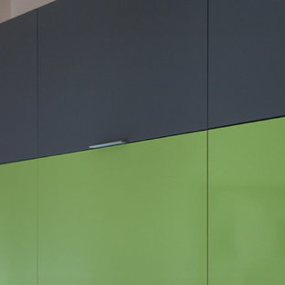 Closeup of gray acrylic slab cabinet doors coordinating with  Formica Lime green