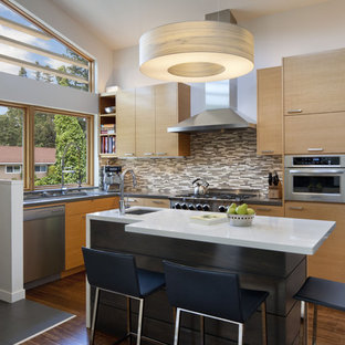 Eat-in kitchen - mid-sized contemporary l-shaped medium tone wood floor eat-in kitchen idea in San Francisco with matchstick tile backsplash, stainless steel appliances, brown backsplash, medium tone wood cabinets, flat-panel cabinets, an undermount sink and an island