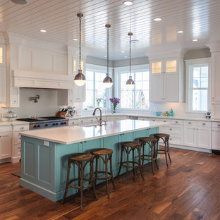 Large transitional eat-in kitchen appliance - Large transitional u-shaped medium tone wood floor and brown floor eat-in kitchen photo in Salt Lake City with an undermount sink, shaker cabinets, white cabinets, quartz countertops, white backsplash, stainless steel appliances and an island