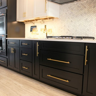 Large transitional l-shaped open plan kitchen in Other with an undermount sink, flat-panel cabinets, black cabinets, quartz benchtops, white splashback, marble splashback, black appliances, vinyl floors, with island and grey floor.