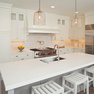 Inspiration for a beach style l-shaped kitchen remodel in Minneapolis with an undermount sink, shaker cabinets, white cabinets and stainless steel appliances
