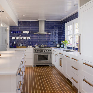 Coastal kitchen photo in Bridgeport with paneled appliances