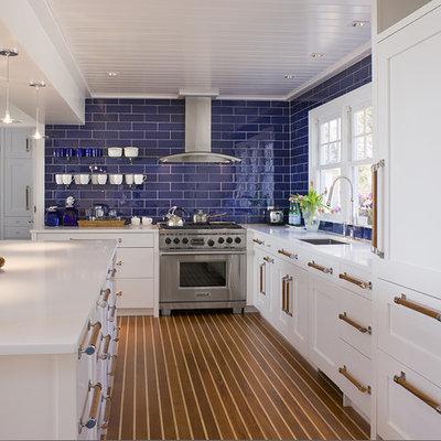 Beach style kitchen photo in Bridgeport with paneled appliances