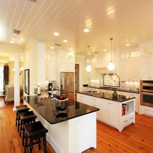 This is an example of a classic kitchen in Jacksonville with stainless steel appliances and multiple islands.