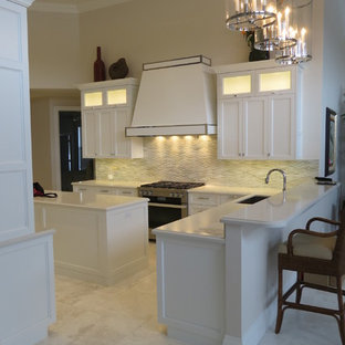 Mid-sized transitional kitchen in Miami with turquoise cabinets, white splashback, ceramic splashback, stainless steel appliances and marble floors.