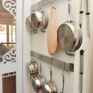 Large farmhouse kitchen pantry designs - Example of a large cottage l-shaped medium tone wood floor kitchen pantry design in Atlanta with stainless steel appliances, a farmhouse sink, raised-panel cabinets, white cabinets, marble countertops, white backsplash, mosaic tile backsplash and an island
