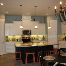 Tropical Kitchen by Mill Creek Custom Homes