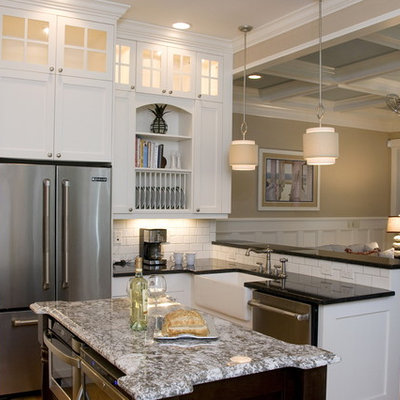 Open concept kitchen - coastal u-shaped open concept kitchen idea in Raleigh with stainless steel appliances, a farmhouse sink, recessed-panel cabinets, white cabinets, granite countertops, white backsplash and subway tile backsplash