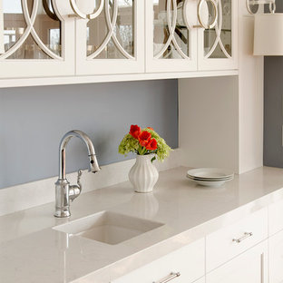 Contemporary kitchen remodeling - Trendy kitchen photo in Portland Maine with quartz countertops