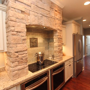 Large transitional eat-in kitchen designs - Inspiration for a large transitional u-shaped dark wood floor eat-in kitchen remodel in Other with an undermount sink, raised-panel cabinets, white cabinets, granite countertops, stainless steel appliances and an island
